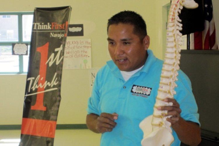 Echohawk Lefthand, Director of Eve's Fund's ThinkFirst Navajo Chapter, teaching school children how to avoid brain and spinal cord injuries.
